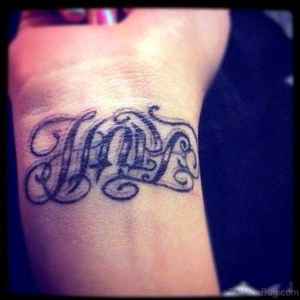 Grey Ink Hope Tattoo On Wrist