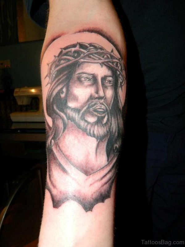 Grey Ink Jesus Face Tattoo On Right Forearm