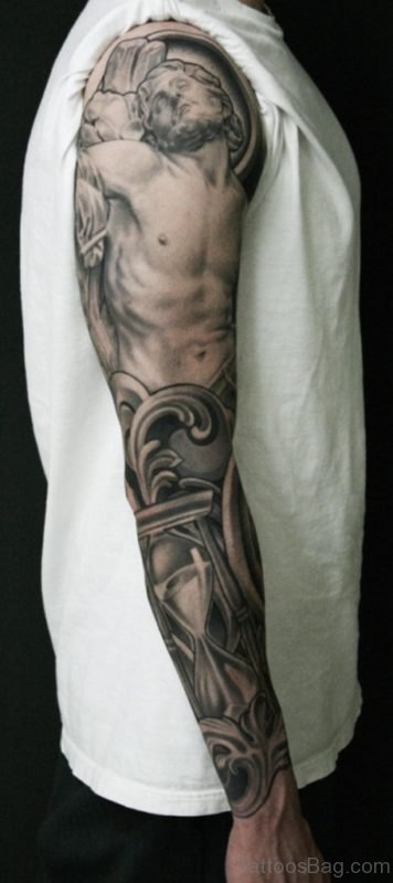 Grey Ink Jesus Face With Hourglass Tattoo On Man Right Full Sleeve