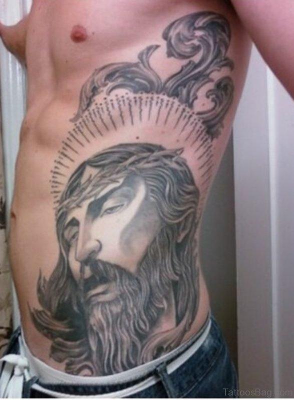 Grey Ink Jesus Head Tattoo On Side Rib