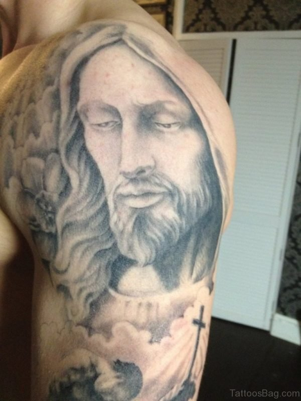 Grey Ink Jesus Portrait Tattoo On Shoulder