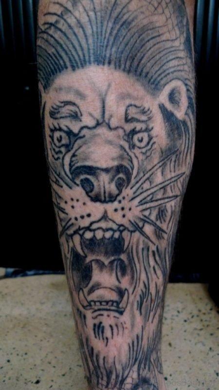 Grey Ink Lion Tattoo On Leg