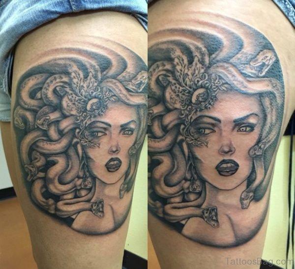 Grey Ink Medusa Face Tattoo On Thigh