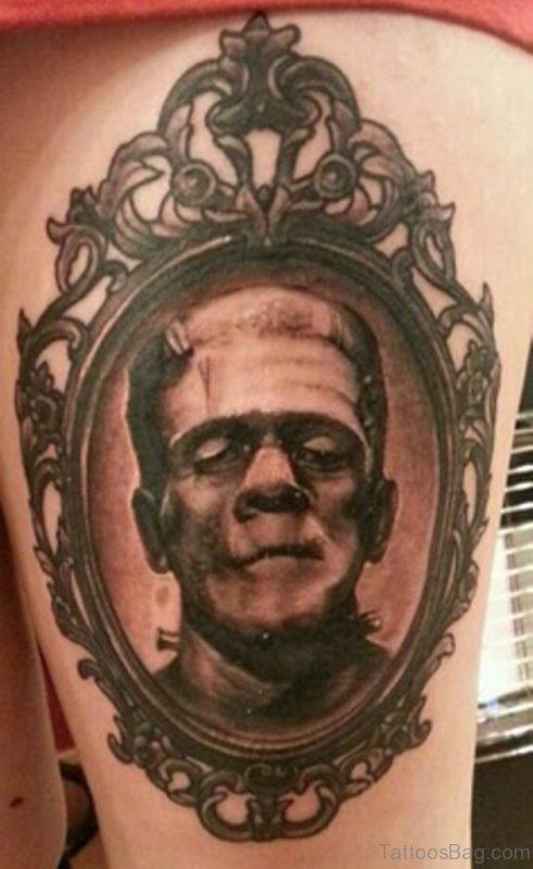 Grey Ink Portrait Tattoo On Thigh