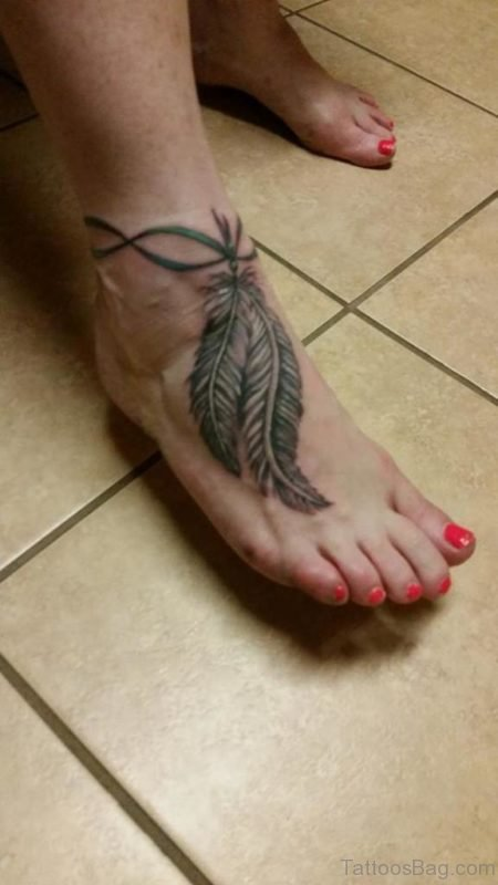 Grey Ink Rosary Feather Tattoo