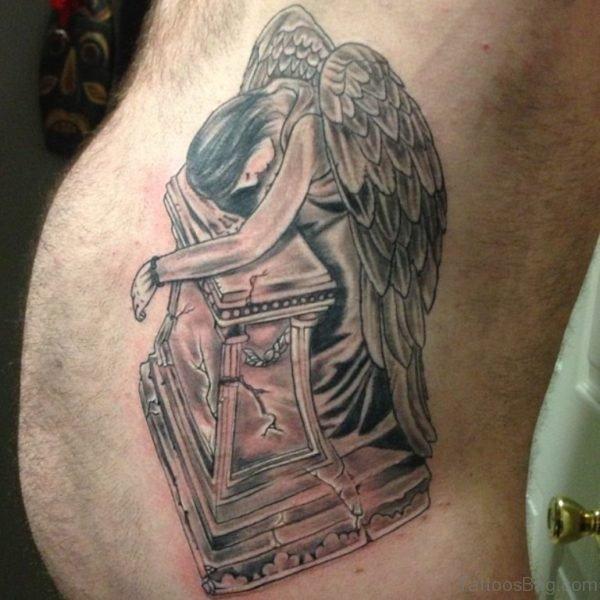Grey Ink Sad Angel Tattoo On Rib Side