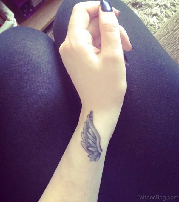 Grey Inked Feather Tattoo On Wrist