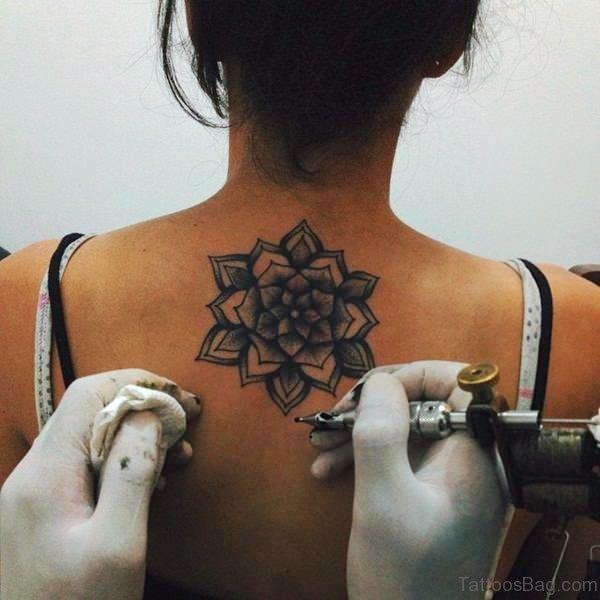 Grey Inked Lotus Tattoo On Neck