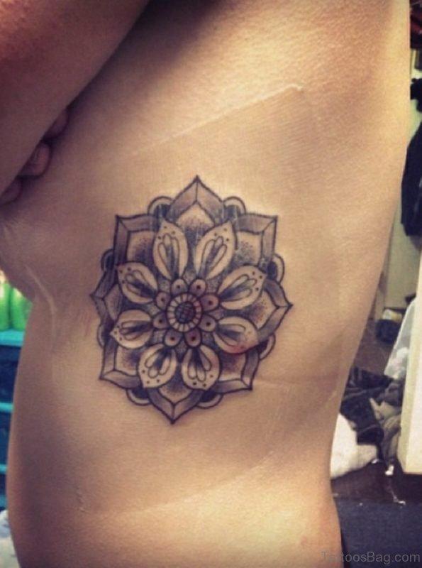 Grey Lotus Tattoo On Rib