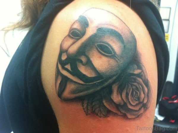 Grey Rose And Mask Tattoo