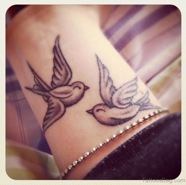 Grey Swallow Tattoo