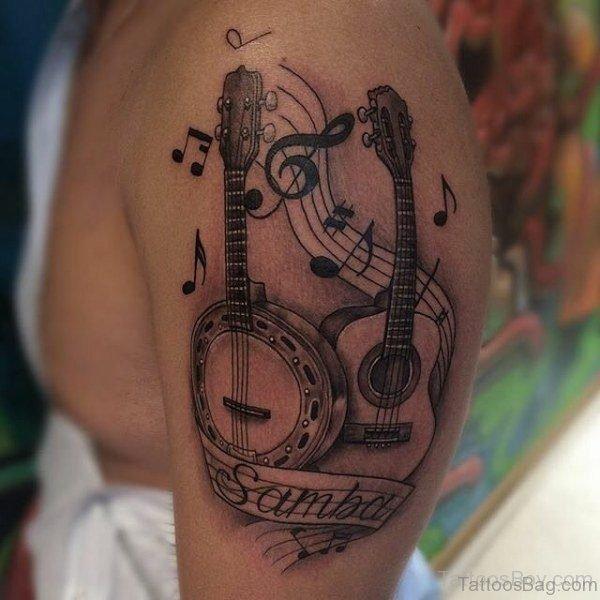 Guitar Tattoo On Shoulder