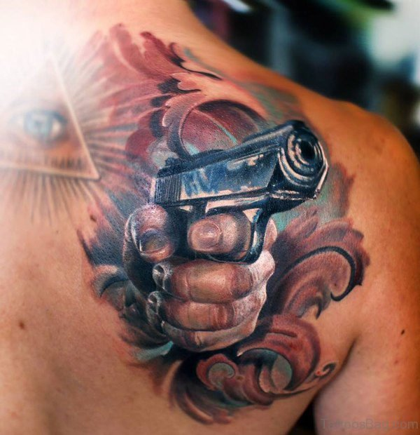 Gun Shoulder Blade Tattoo Desig