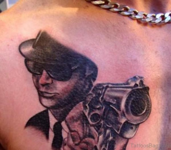 Guy With Gun Dark Ink Portrait Tattoo On Chest