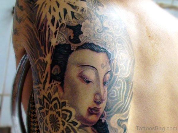 Half Side Buddha Tattoo On Back