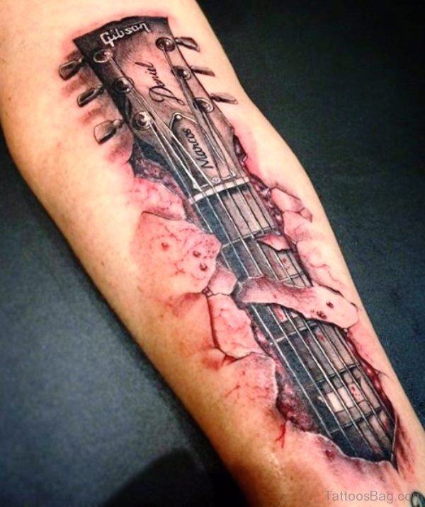 Hand Playing Guitar Tattoo On Forearm