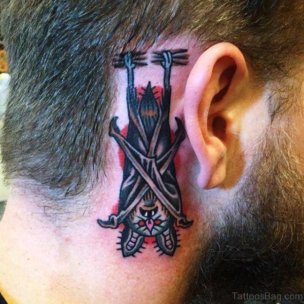 Hanging Bat Tattoo Behind Ears