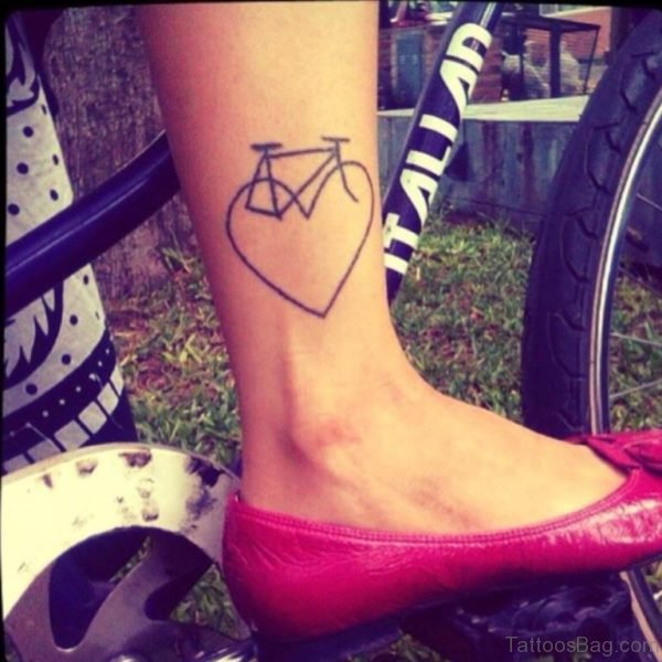 Heart And Bike Tattoo On Girl Right Leg