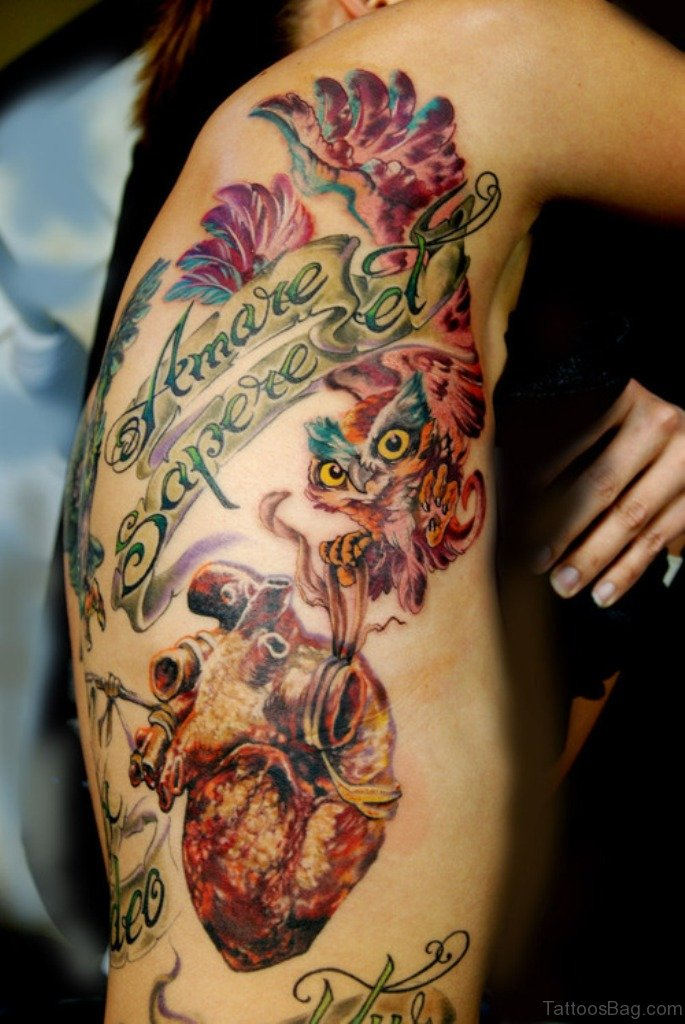 47 mind blowing owl tattoos on rib for Owl heart tattoo