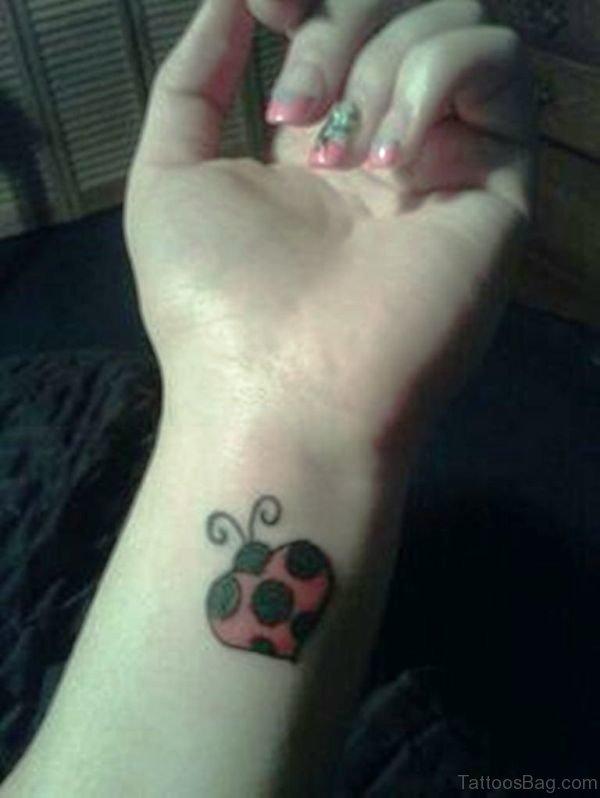 Heart Shape Ladybug Wrist Tattoo