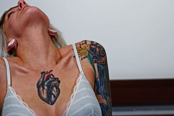 Heart Tattoo On Girl Chest