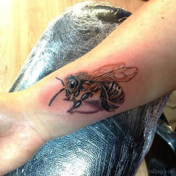 Huge Bee Tattoo On Wrist