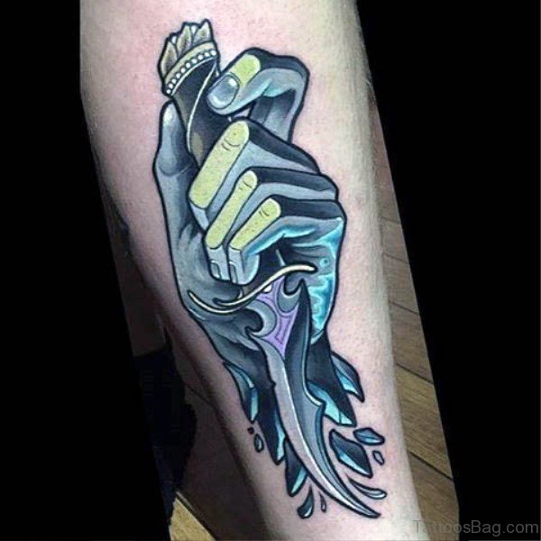 Icy Hand Holding Dagger Tattoo On Arm