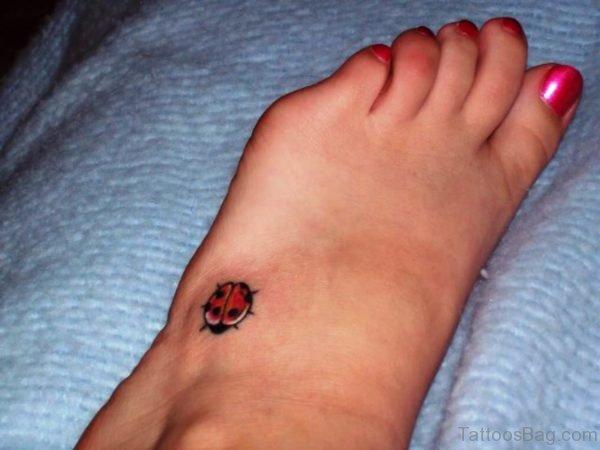 Image Of Ladybug Tattoo On Foot