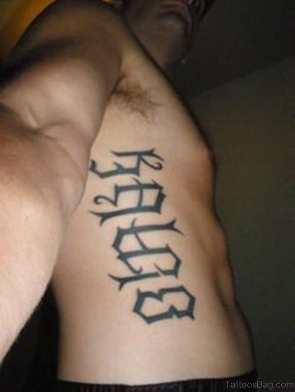 Impressive Ambigram Tattoo On Rib
