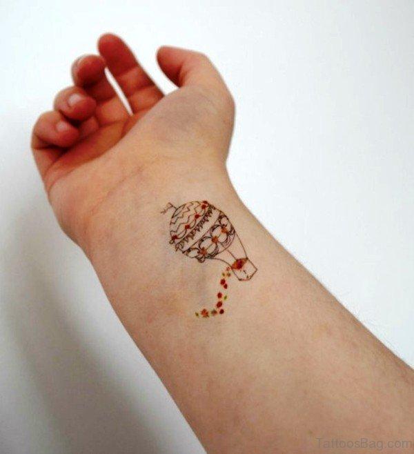 12b1711b3268f Impressive Balloon Tattoo On Wrist