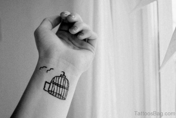 Impressive Birdcage Tattoo On Wrist