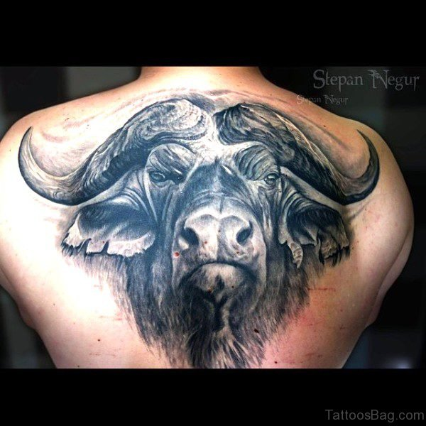 Impressive Black Bull Tattoo Face On Back