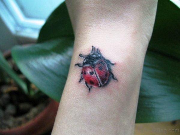 Impressive Ladybug Wrist Tattoo