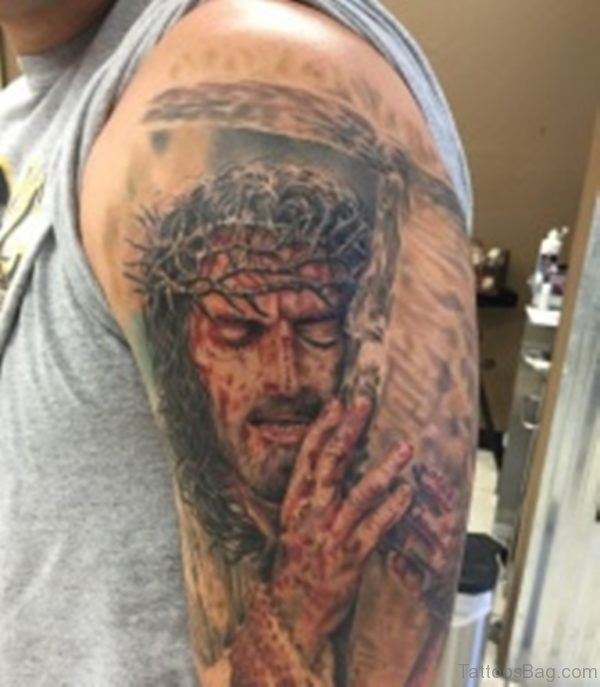 Jesus Holding Cross Tattoo