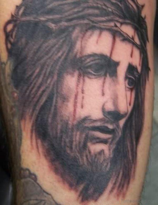 Jesus Injured Face Tattoo