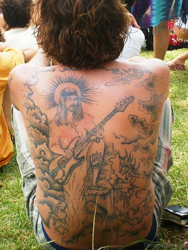 Jesus Playing Guitar Tattoo On Back