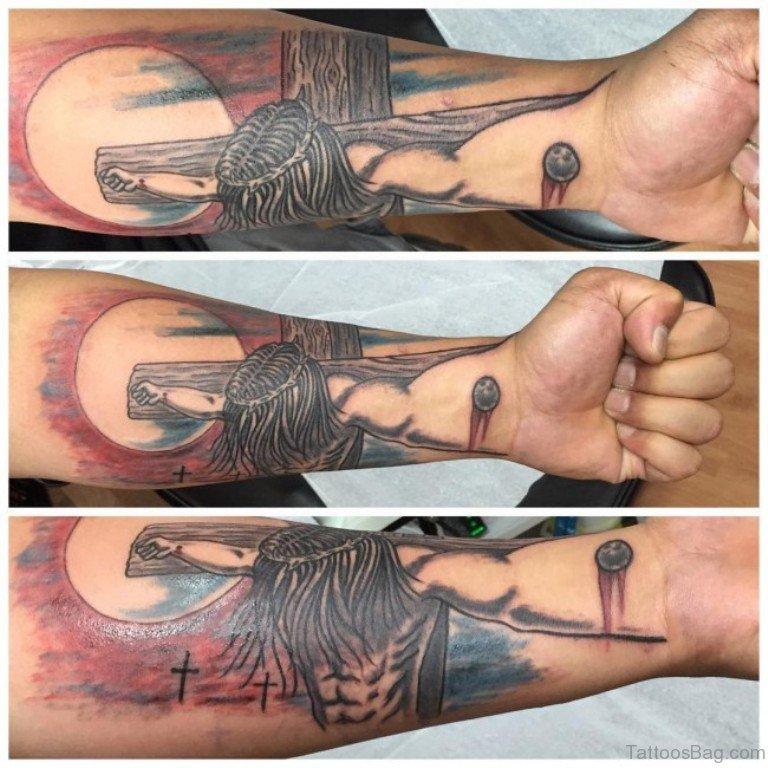 Jesus cross tattoo arm
