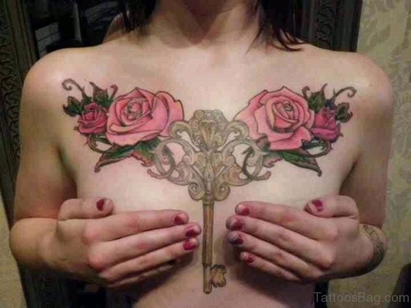 Key And Rose Tattoo On Chest