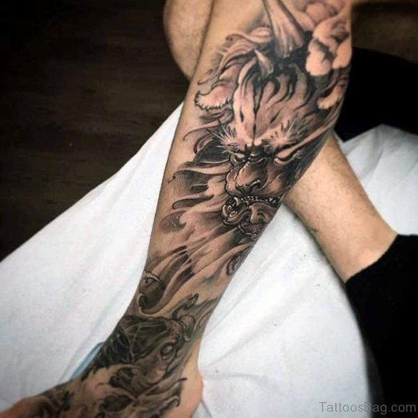 Koi Fish Tattoo On Man Leg