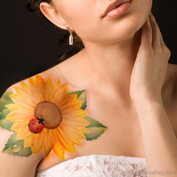 Lady Bug On Yellow Flower Tattoo