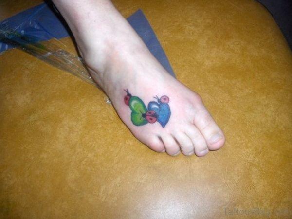 Ladybug On Heart Tattoo On Right Foot