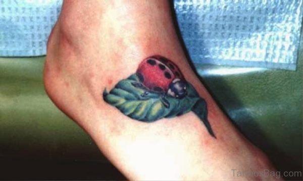 Ladybug On Leaf Tattoo