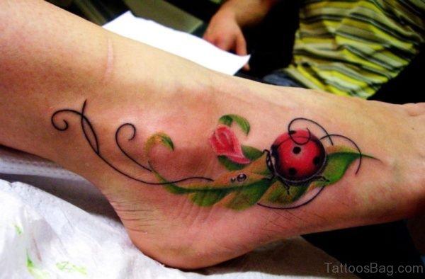 Ladybug On Leaves Tattoo On Foot