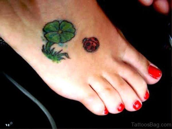 Ladybug With Shamrock Flowers Tattoo