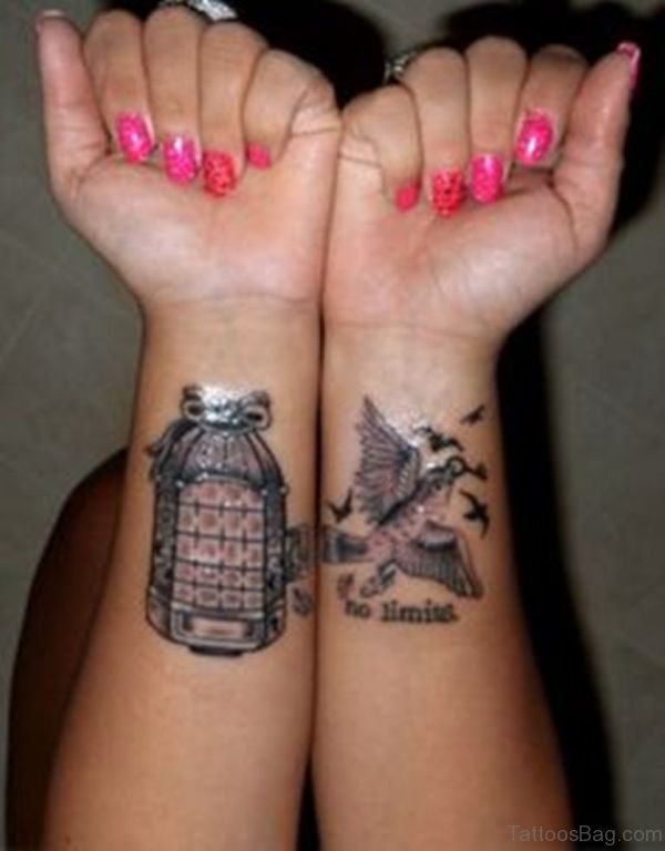 Large Bird And Cage Tattoo On Wrist