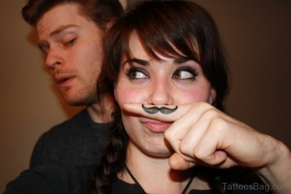 Large Mustache Finger Tattoo