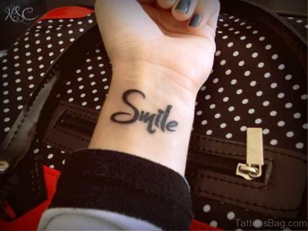 Large Smile Tattoo On Wrist