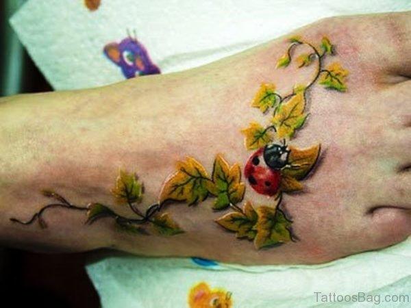 Leaves With Ladybug Tattoo On Foot