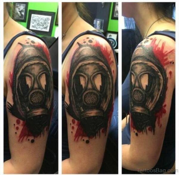 Left Shoulder Black And Grey Gas Mask Tattoo
