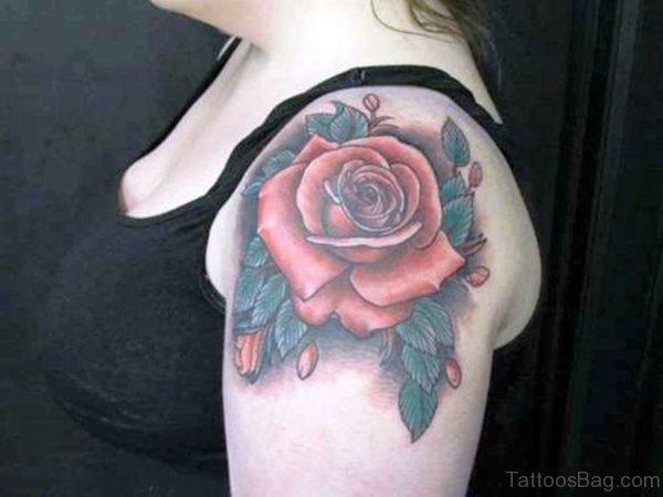 Light Red Flower Tattoo On Shoulder